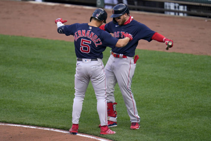 Boston Red Sox's Enrique Hernandez (5) celebrates his solo home run against the Baltimore Orioles with Alex Verdugo during the eighth inning of a baseball game, Thursday, April 8, 2021, on Opening Day in Baltimore. The Red Sox won 7-3. (AP Photo/Julio Cortez)