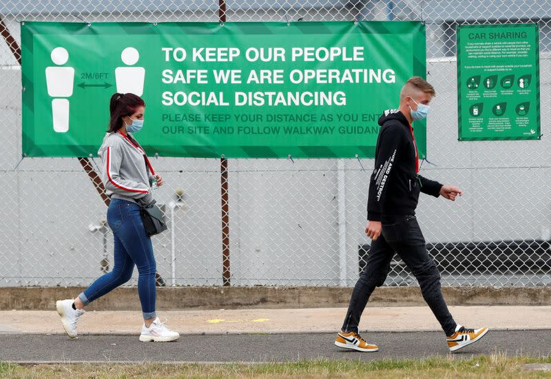 Members of staff leave the Greencore sandwich factory, in Northampton