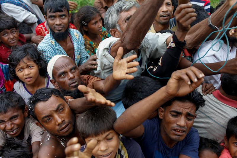 Rohingya refugees wait for aid at Kutupalong refugee camp in the town of Teknaf, Bangladesh, on Sept. 5, 2017.