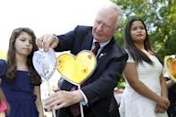 Canada's Governor General David Johnston adjusts a heart shaped card in the Heart Garden which is meant to symbolize reconciliation during the Truth and Reconciliation Commission of Canada closing ceremony at Rideau Hall in Ottawa June 3, 2015. REUTERS/Blair Gable