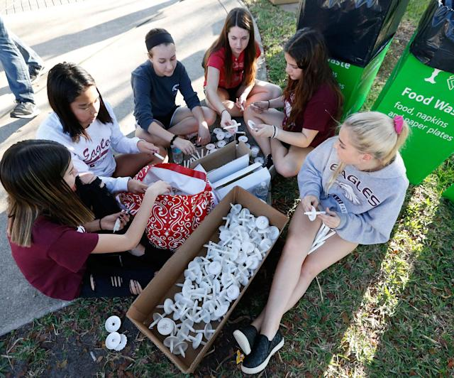 <p>Students put together candles before the start of a candlelight vigil for the victims of the shooting at Marjory Stoneman Douglas High School, Thursday, Feb. 15, 2018, in Parkland, Fla. (Photo: Wilfredo Lee/AP) </p>