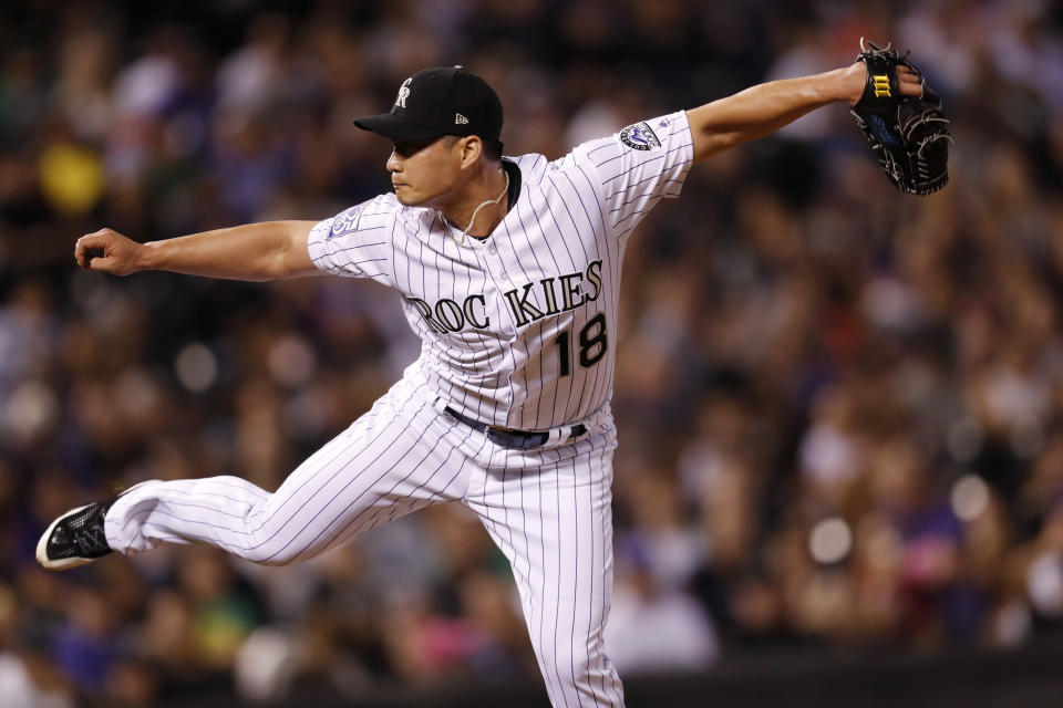 Seunghwan Oh has a new number now that he's with the Rockies. (AP Photo/David Zalubowski)