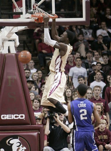 Florida State's Okaro White gets past the defense of Duke's Quinn Cook for a dunk during the second half of an NCAA college basketball game Saturday, Feb. 2, 2013, in Tallahassee, Fla. Duke won 79-60. (AP Photo/Steve Cannon)