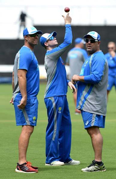Australia's captain Steve Smith (C) is watched by coach Darren Lehmann (R) during a practice session at The M. Chinnaswamy Stadium in Bangalore, on March 1, 2017