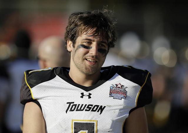 Towson quarterback Peter Athens (7) walks along the bench talking with teammates late in the second half of the FCS championship NCAA college football game against North Dakota State, Saturday, Jan. 4, 2014, in Frisco, Texas. NDSU won 35-7. (AP Photo/Tony Gutierrez)
