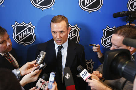 FILE PHOTO - Steve Yzerman, general manager of the Tampa Bay Lightning, speaks to media before Commissioner Gary Bettman announces the end of labor negotiations between the NHL and the NHL Players Association (NHLPA) in New York, January 9, 2013. REUTERS/Lucas Jackson