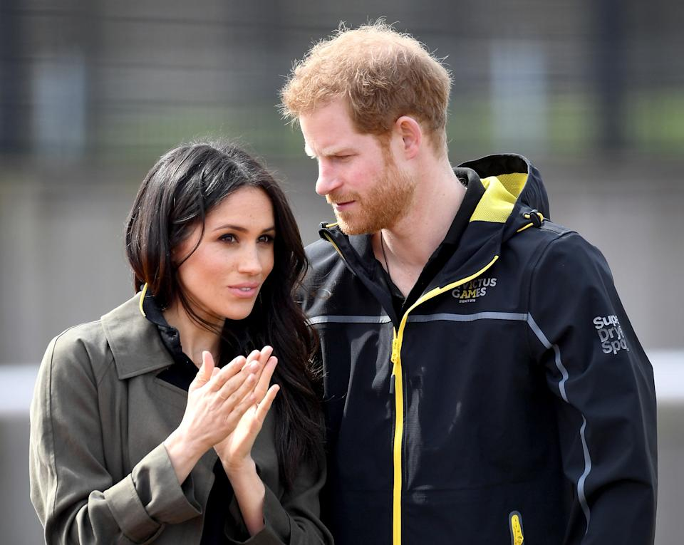 BATH, ENGLAND - APRIL 06:  Meghan Markle (L) and Prince Harry, Patron of the Invictus Games Foundation attend the UK Team Trials for the Invictus Games Sydney 2018 at the University of Bath Sports Training Village on April 6, 2018 in Bath, England. The Invictus Games Sydney 2018 will take place from 20-27th October and will see over 500 competitors from 18 nations compete in 11 adaptive sports.  (Photo by Samir Hussein/Samir Hussein/WireImage)