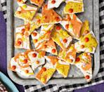 """<p>It's a play on the candy corn you already know and (hopefully) love! Swirls of orange and yellow candy melts meet crunchy graham crackers in this inspired Halloween dessert.</p><p><strong><a href=""""https://www.thepioneerwoman.com/food-cooking/recipes/a34030701/candy-corn-bark-recipe/"""" rel=""""nofollow noopener"""" target=""""_blank"""" data-ylk=""""slk:Get the recipe."""" class=""""link rapid-noclick-resp"""">Get the recipe.</a></strong> </p><p><a class=""""link rapid-noclick-resp"""" href=""""https://go.redirectingat.com?id=74968X1596630&url=https%3A%2F%2Fwww.walmart.com%2Fbrowse%2Fhome%2Ffood-storage-containers%2Fthe-pioneer-woman%2F4044_623679_1032619_5842891%2FYnJhbmQ6VGhlIFBpb25lZXIgV29tYW4ie&sref=https%3A%2F%2Fwww.thepioneerwoman.com%2Ffood-cooking%2Fmeals-menus%2Fg32110899%2Fbest-halloween-desserts%2F"""" rel=""""nofollow noopener"""" target=""""_blank"""" data-ylk=""""slk:SHOP FOOD STORAGE"""">SHOP FOOD STORAGE</a></p>"""