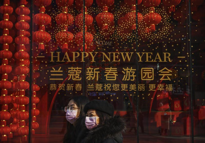 BEIJING, CHINA - JANUARY 25: Chinese women wear masks as they walk by a window display marking the Chinese New Year and Spring Festival on January 25, 2020 in Beijing, China. The number of cases of a deadly new coronavirus rose to over 1300 in mainland China Saturday as health officials locked down the city of Wuhan earlier in the week in an effort to contain the spread of the pneumonia-like disease which medicals experts have been confirmed can be passed from human to human. In an unprecedented move, Chinese authorities put travel restrictions on the city of Wuhan and neighbouring cities affecting a population of over 35 million. The number of those who have died from the virus in China climbed to at least 41 on Saturday and cases have been reported in other countries including the United States, Australia, France, Thailand, Japan, Taiwan and South Korea. (Photo by Kevin Frayer/Getty Images)