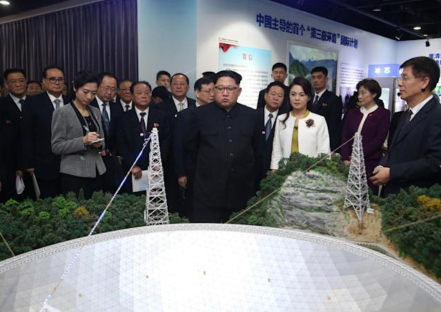 <p>In this photo released Wednesday, March 28, 2018 by China's Xinhua News Agency, North Korean leader Kim Jong Un, center, and his wife Ri Sol Ju, visit an exhibition highlighting achievements by the Chinese Academy of Sciences. (Photo: Yao Dawei/Xinhua via AP) </p>