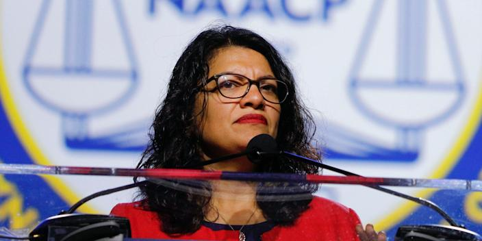 """U.S. Rep. Rashida Tlaib (D-MI) speaks at the opening plenary session of the NAACP 110th National Convention at the COBO Center on July 22, 2019 in Detroit, Michigan. The convention is from July 20 to July 24 with the theme of, """"When We Fight, We Win""""."""