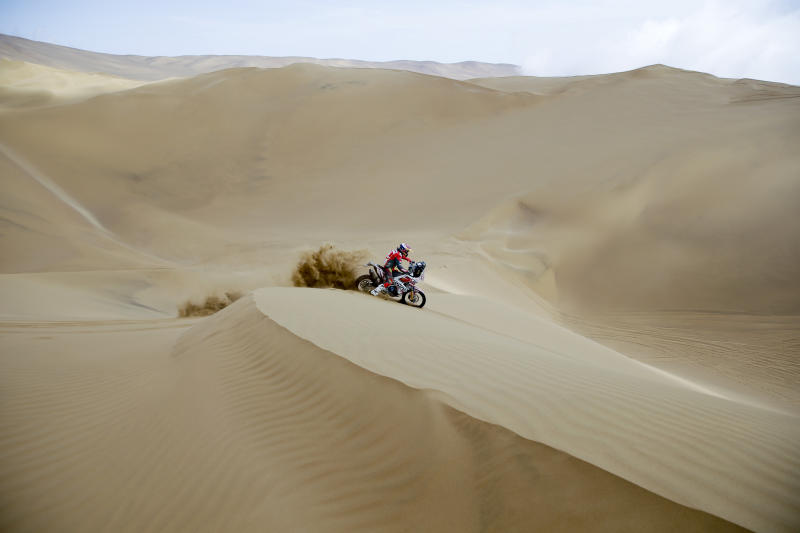 Anastasiya Nifontova of Russia rides her Husqvarna motorbike during the stage five of the Dakar Rally between Tacna and Arequipa, Peru, Friday, Jan. 11, 2019. (AP Photo/Ricardo Mazalan)