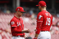 Cincinnati Reds starting pitcher Sonny Gray (54) reacts alongside first baseman Joey Votto (19) after being hit by a single off Miami Marlins' Miguel Rojas in the second inning of a baseball game, Thursday, April 11, 2019, in Cincinnati. (AP Photo/John Minchillo)