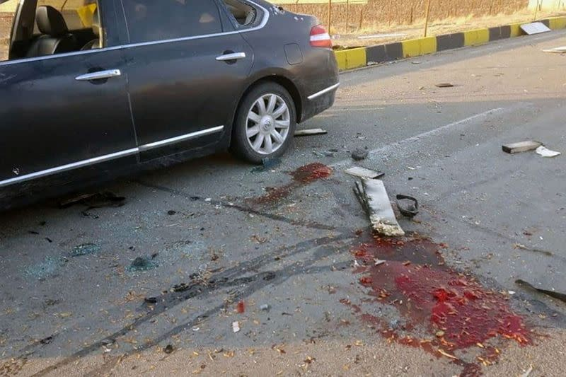 Blood stains are seen on the ground at the site of the attack that killed Prominent Iranian scientist Mohsen Fakhrizadeh, outside Tehran