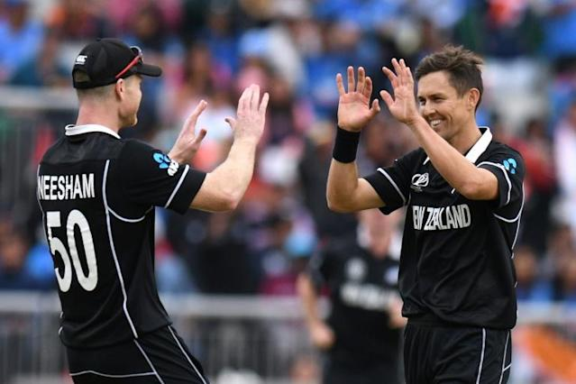 Bowling heroes: Trent Boult (tight) and James Neesham (AFP Photo/Oli SCARFF)