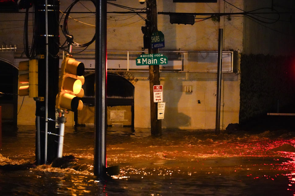 Flooding rose halfway to a street sign in the Manayunk section of Philadelphia on Thursday.