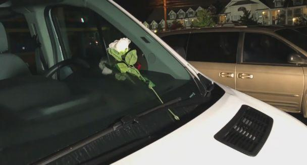 PHOTO: A single white rose was left on the windshield of one of the vehicles the in parking lot of 'Ride the Ducks' in Branson, Mo. after one of their vehicles capsized, July 19, 2018. (KOLR )