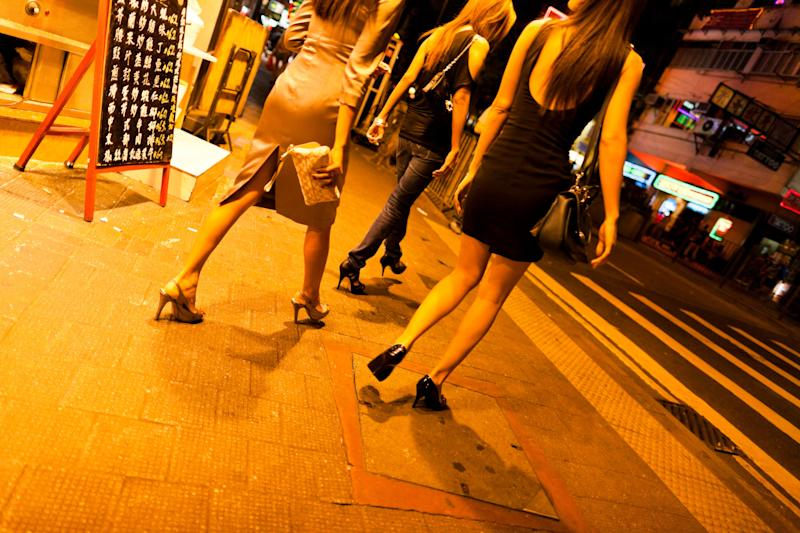 Hong Kong, China - October 4, 2011: Prostitutes walking the street in the red light district of Wanchai in Hong Kong
