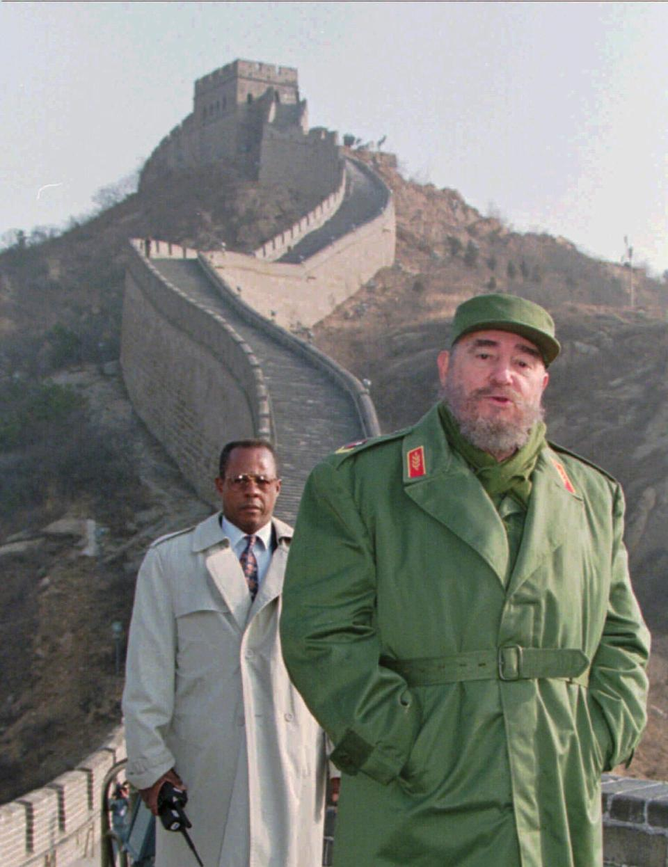 <p>Cuban President Fidel Castro stands on the Great Wall of China, 70 kilometers north of Beijing, Friday December 1, 1995. Castro, who is in China to boost trade and study the country's market oriented economy, was to spend the day sight-seeing before an evening meeting with Premier Li Peng. (AP Photo/Greg Baker) </p>