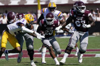 Mississippi State running back Dillon Johnson (23) rushes for short yardage as LSU safety Jay Ward (5) pursues during the first half of an NCAA college football game, Saturday, Sept. 25, 2021, in Starkville, Miss. (AP Photo/Rogelio V. Solis)