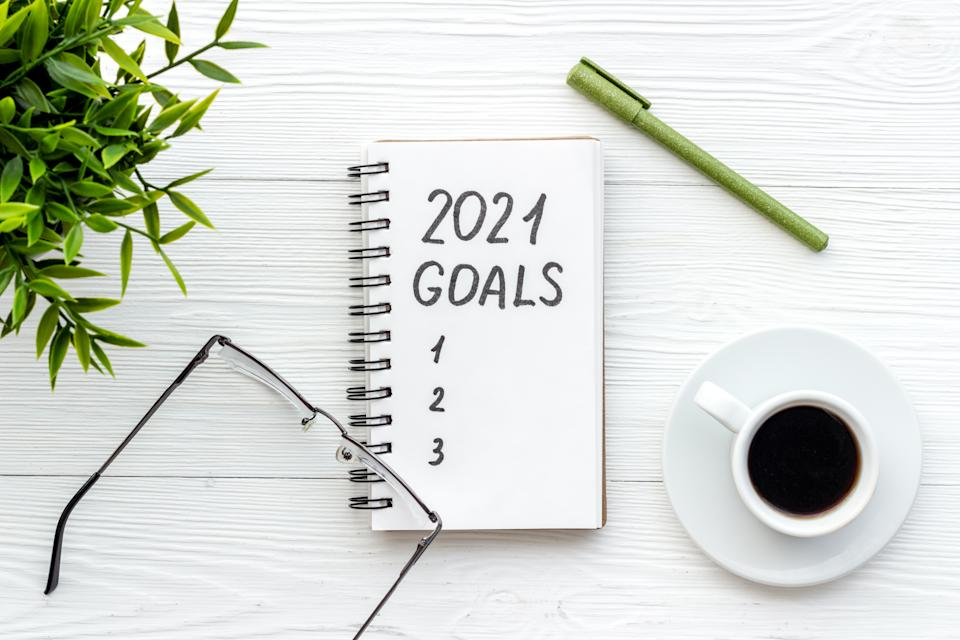 New Years goals written in notebook on a table.