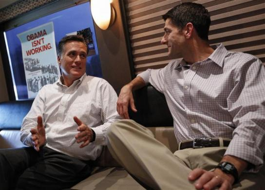 Mitt Romney (L) speaks with vice Paul Ryan on their campaign bus before a campaign event in Waukesha, Wisconsin August 12, 2012.