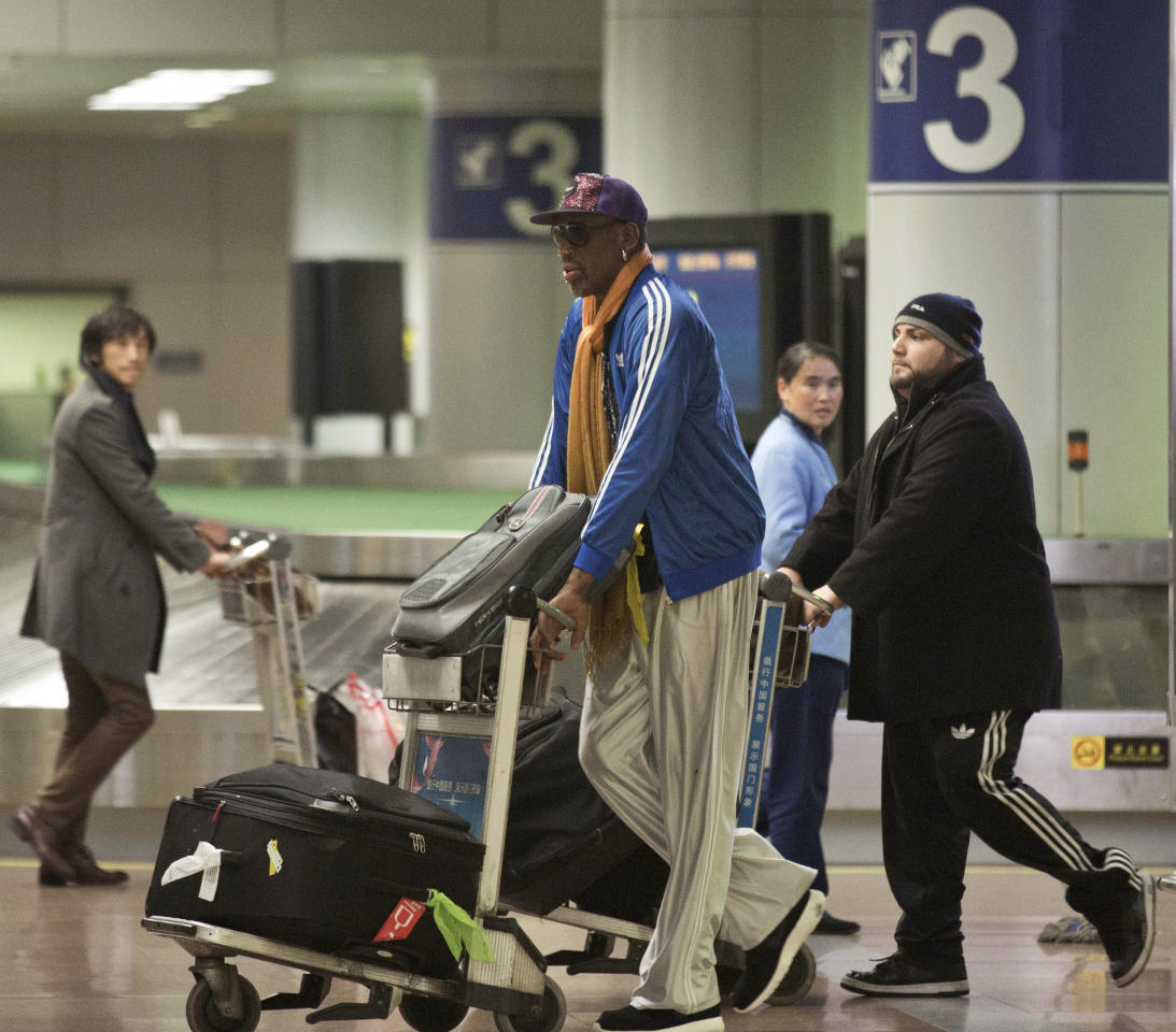 Former NBA basketball player Dennis Rodman pushes his luggage cart as he arrives at the Capital International Airport in Beijing from Pyongyang, Monday, Jan. 13, 2014. A squad of former basketball stars led by Rodman had a friendly game with North Korean basketball players in Pyongyang. (AP Photo/Alexander F. Yuan)