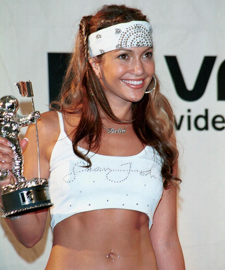 """<h3><strong>2000</strong></h3><br>The braided pigtails. The white bandana. The belly button rhinestones! This look will forever be our early-aughts Halloween costume inspiration.<span class=""""copyright"""">Photo: Steve Azzara/Corbis/Getty Images.</span>"""