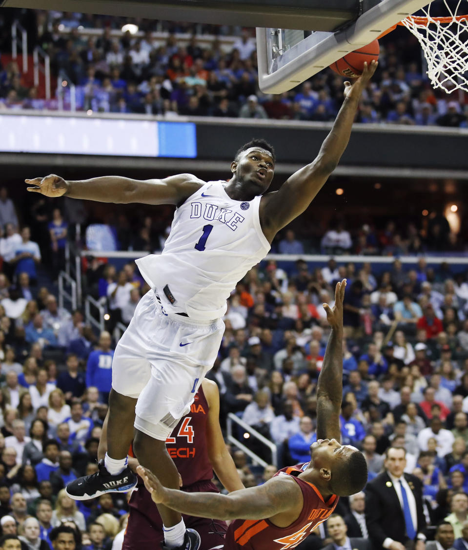 FILE - In this March 29, 2019, file photo, Duke forward Zion Williamson (1) drives to the basket to score over Virginia Tech's guard Ty Outlaw (42) during the second half of an East Region semifinal in the NCAA college basketball tournament in Washington. Williamson was selected as one of the top college basketball players of the decade. (AP Photo/Alex Brandon, File)