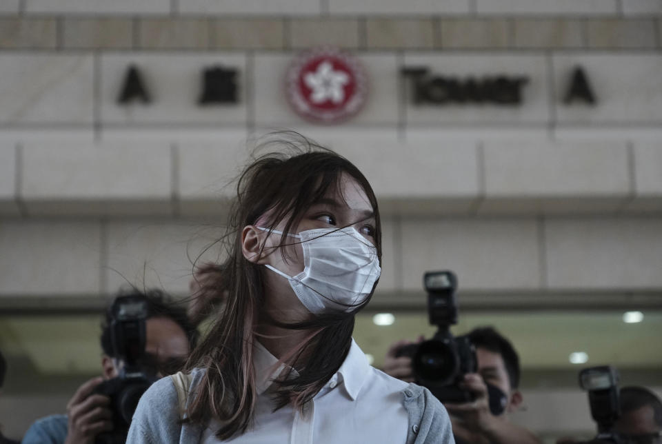 Hong Kong activist Agnes Chow arrives at a court in Hong Kong, Monday, Nov. 22. 2020. Hong Kong pro-democracy activists Joshua Wong, Agnes Chow and Ivan Lam appear at court for their trial as the trio faces charges related to the besieging of a police station during anti-government protests last year. (AP Photo/Vincent Yu)