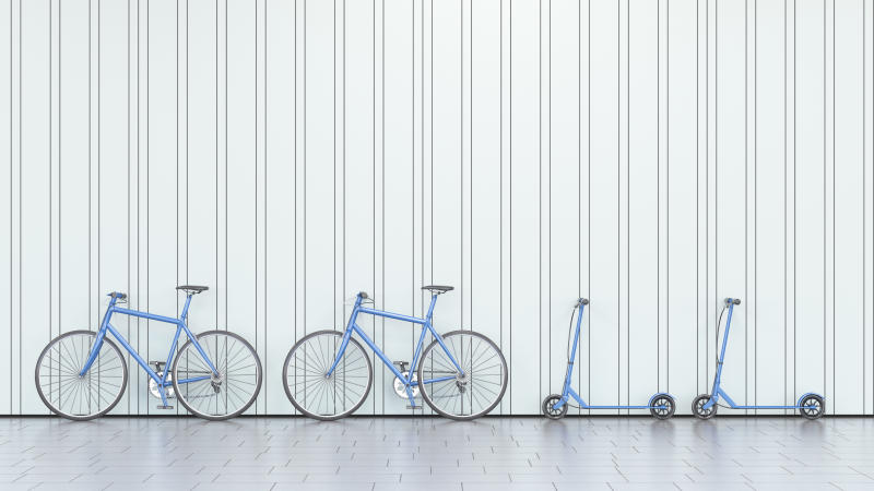 Bicycles and scooters leaning against a wall, 3d rendering