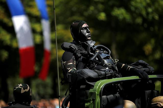 <p>A camouflaged special forces member attends the traditional Bastille day military parade on the Champs-Elysees in Paris, France, July 14, 2017. (Photo: Stephane Mahe/Reuters) </p>