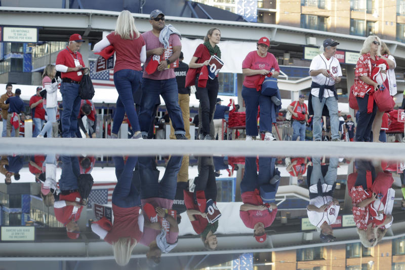 Fans arrive for Game 5 of the baseball World Series between the Houston Astros and the Washington Nationals Sunday, Oct. 27, 2019, in Washington. (AP Photo/Pablo Martinez Monsivais)