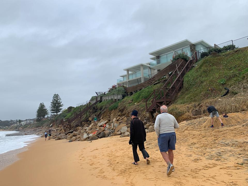 Pictured is a home backing onto Wamberal Beach on a cliff edge.