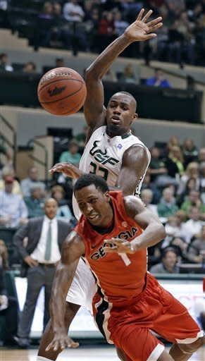 Georgia guard Kentavious Caldwell-Pope (1) is fouled by South Florida forward Kore White (33) during the first half of an NCAA college basketball game Friday, Nov. 30, 2012, in Tampa, Fla. (AP Photo/Chris O'Meara)