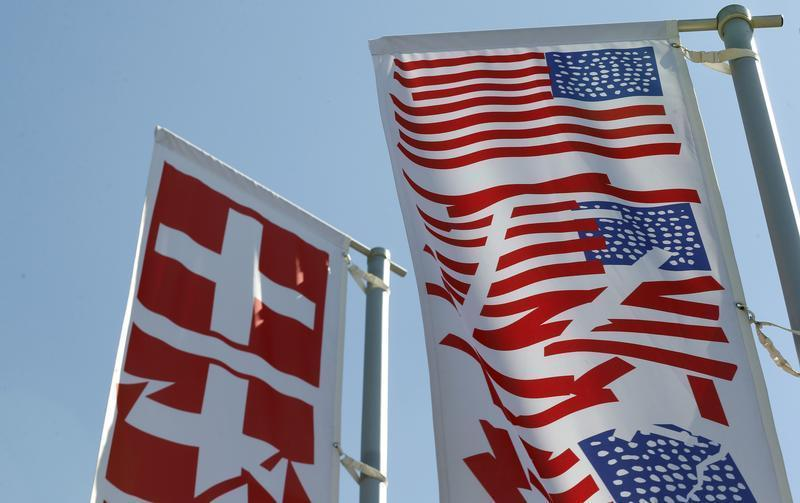 Stylized Swiss and US national flags fly on a roundabout in the town of Obersiggenthal