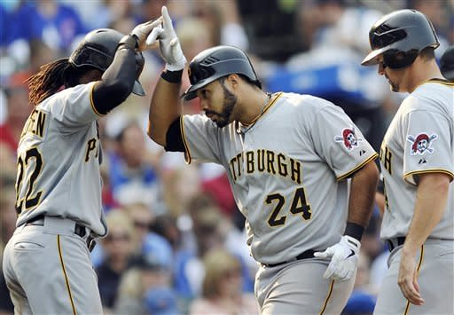 Pittsburgh Pirates' Pedro Alvarez (24) celebrates with Andrew McCutchen left, while Gabby Sanchez, right, watches after Alvarez hit a three-run home run in the sixth inning during a baseball game against the Chicago Cubs in Chicago, Sunday, Sept. 16, 2012. Chicago won 13-9. (AP Photo/Paul Beaty)