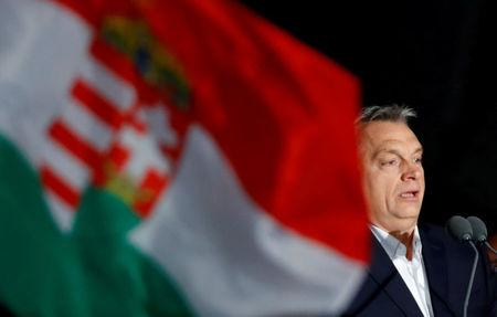 FILE PHOTO: Hungarian Prime Minister Viktor Orban addresses the supporters after the announcement of the partial results of parliamentary election in Budapest, Hungary, April 8, 2018.  REUTERS/Leonhard Foeger/File Photo