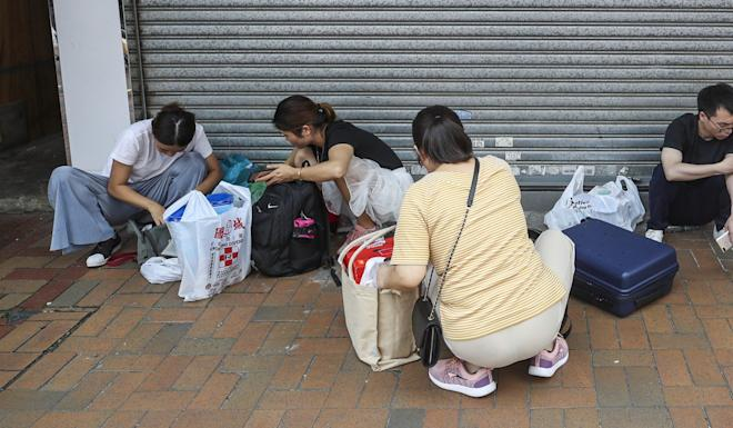 Mainland tourists stocking up on provisions in Sheung Shui. Photo: Winson Wong
