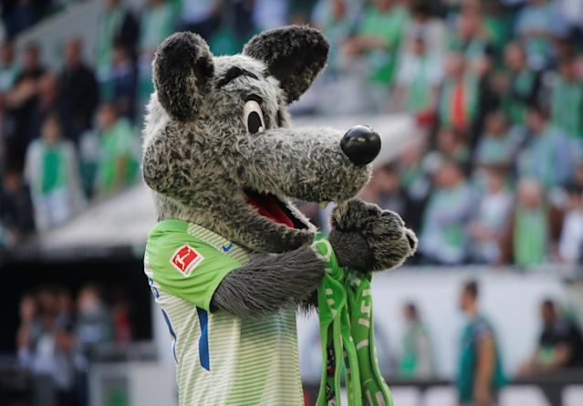 Soccer Football - Bundesliga - VfL Wolfsburg v FC Cologne - Volkswagen Arena, Wolfsburg, Germany - May 12, 2018 Wolfsburg mascot celebrates after the match REUTERS/Wolfgang Rattay DFL RULES TO LIMIT THE ONLINE USAGE DURING MATCH TIME TO 15 PICTURES PER GAME. IMAGE SEQUENCES TO SIMULATE VIDEO IS NOT ALLOWED AT ANY TIME. FOR FURTHER QUERIES PLEASE CONTACT DFL DIRECTLY AT + 49 69 650050