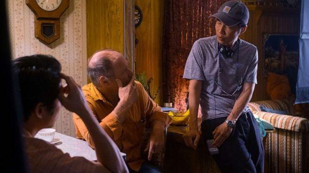 PHOTO: Steven Yeun, left, and Will Patton, center, with Director Lee Isaac Chung on the set of 'Minari.'  (Joe Rushmore/A24)