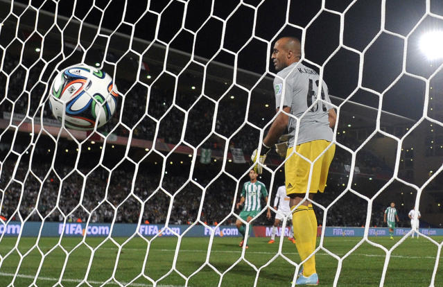 The ball is seen in the net after a goal against Morocco's Raja Casablanca during their semi-final football match as part of the 2013 FIFA Club World Cup, in Marrakesh on December 18, 2013 (AFP Photo/Gerard Julien)