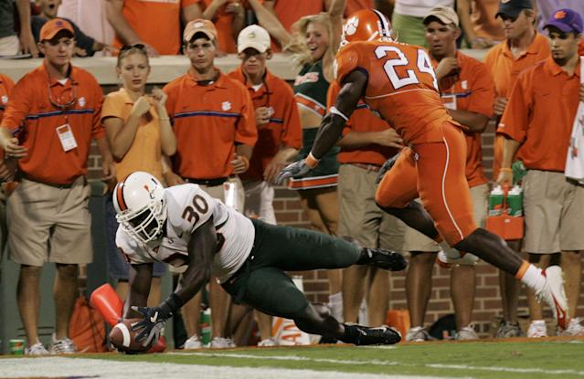 Tyrone Moss rushed for 1,942 yards and 26 touchdowns in his Miami career. (AP Photo/Mary Ann Chastain)