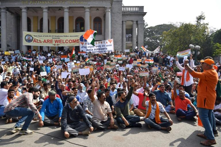 People demonstrate in Bangalore to support India's new citizenship law, which is criticized as anti-Muslim (AFP Photo/Manjunath Kiran)