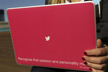 A Twitter logo is shown on a laptop computer at the company's headquarters in San Francisco