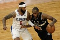 Milwaukee Bucks' Khris Middleton drives past LA Clippers' Marcus Morris Sr. during the second half of an NBA basketball game Sunday, Feb. 28, 2021, in Milwaukee. (AP Photo/Morry Gash)
