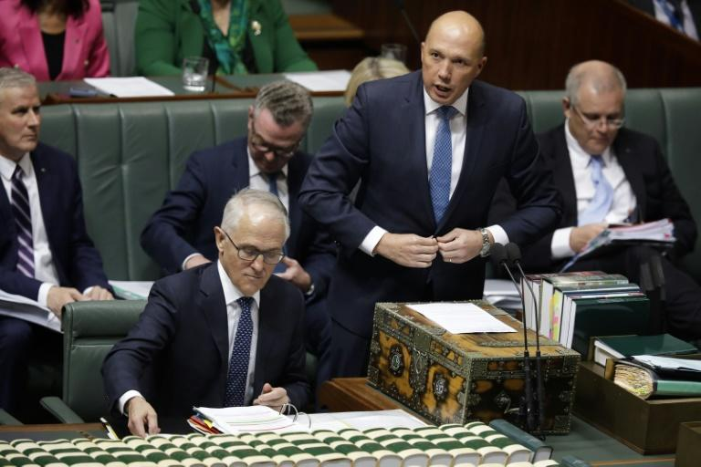 Peter Dutton (standing) quit his ministerial role and headed to the backbench after the failed leadership challenge