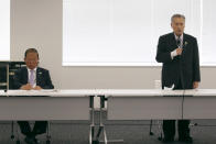 """Tokyo 2020 Organizing Committee President Yoshiro Mori, right, speaks as CEO Toshiro Muto listens during the the first meeting of the """"Tokyo 2020 New Launch Task Force"""" in Tokyo, Thursday, March 26, 2020, two days after the unprecedented postponement was announced due to the spreading coronavirus. The new Tokyo Olympics need dates for the opening and closing ceremony in 2021. Nothing moves until this is worked out by the International Olympic Committee, the Japanese government, and Tokyo organizers. (AP Photo/Koji Sasahara)"""