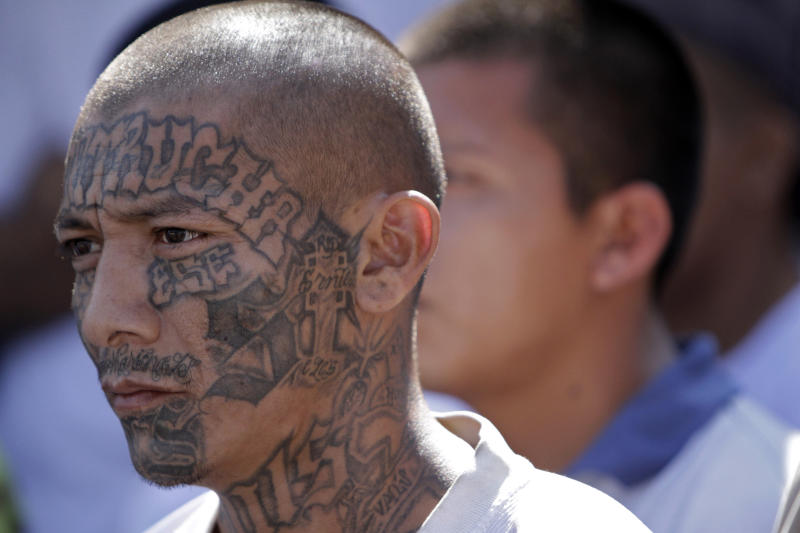 A Mara Salvatrucha gang member attends a mass celebrated by Archbishop Luigi Pezzuto, Apostolic Nuncio to El Salvador, and head army and police chaplain Monsignor Fabio Colindres at a prison in Ciudad Barrios, El Salvador, Monday, March 26, 2012. According to Dionisio Aristides Umanzor, known as El Sirra, leader of the Mara Salvatrucha gang, leaders of the Mara Salvatrucha and the Mara 18, El Salvador's two largest street gangs, have reached a truce, reducing the country's homicide rate, one of the highest in the world. (AP Photo/Luis Romero)