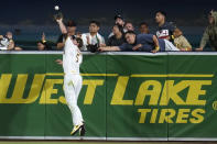 San Diego Padres right fielder Wil Myers makes the catch over the wall for the out on San Francisco Giants' Steven Duggar during the eighth inning of a baseball game Tuesday, Sept. 21, 2021, in San Diego. (AP Photo/Gregory Bull)